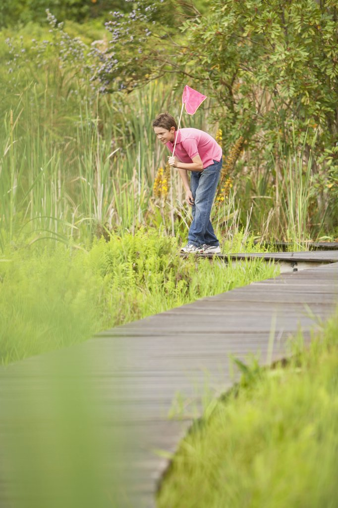 Stock Photo: 1654R-14251 Boy Looking for Wildlife in Marsh
