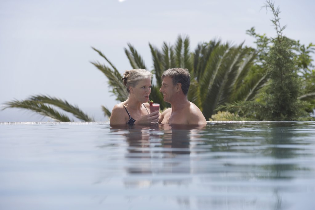 Stock Photo: 1654R-14348 Couple Enjoying a Smoothie in the Pool