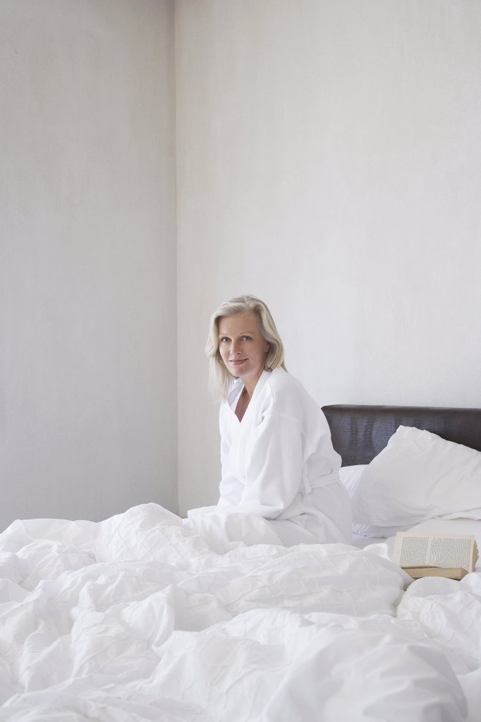 Woman Relaxing in Bed : Stock Photo