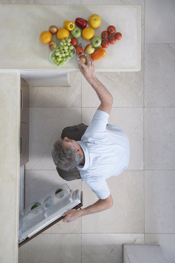 Man Organizing Fresh Vegetables : Stock Photo
