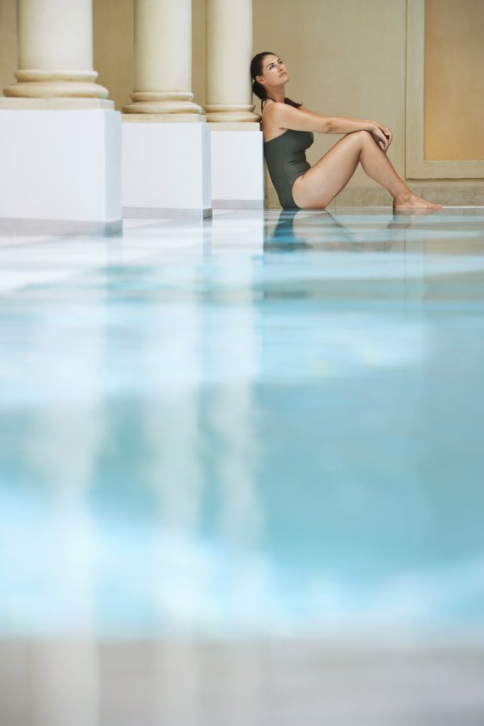 Stock Photo: 1654R-14425 Woman Thinking by Pool
