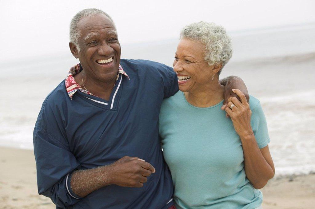 Senior couple embracing at beach : Stock Photo