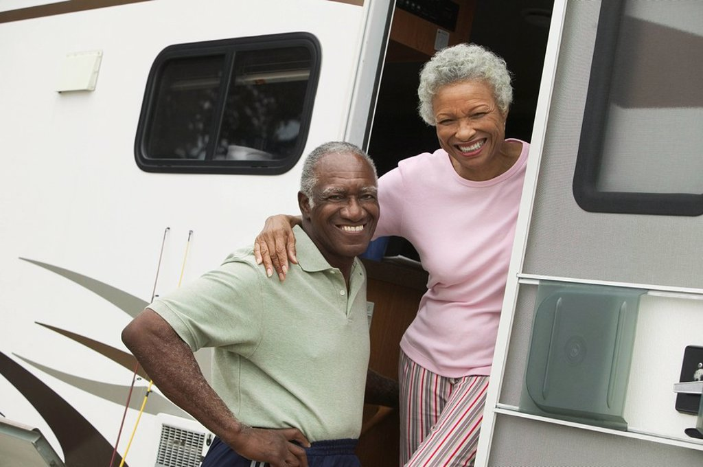 Senior couple with motor home portrait : Stock Photo