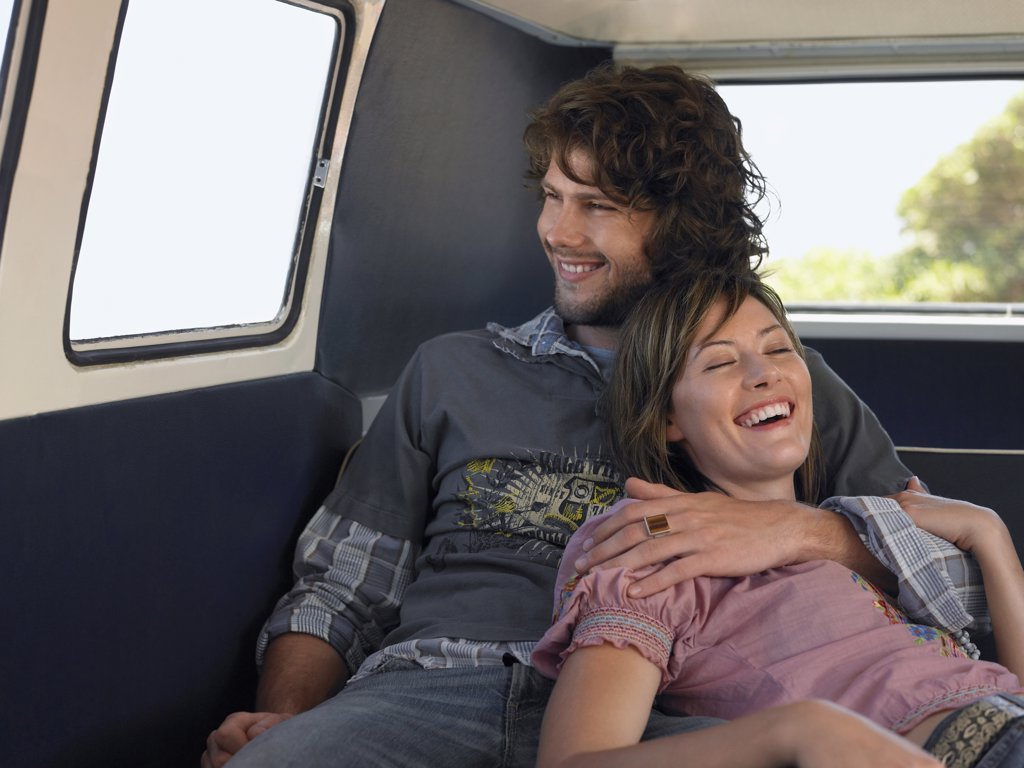 Couple Cuddling in Van : Stock Photo