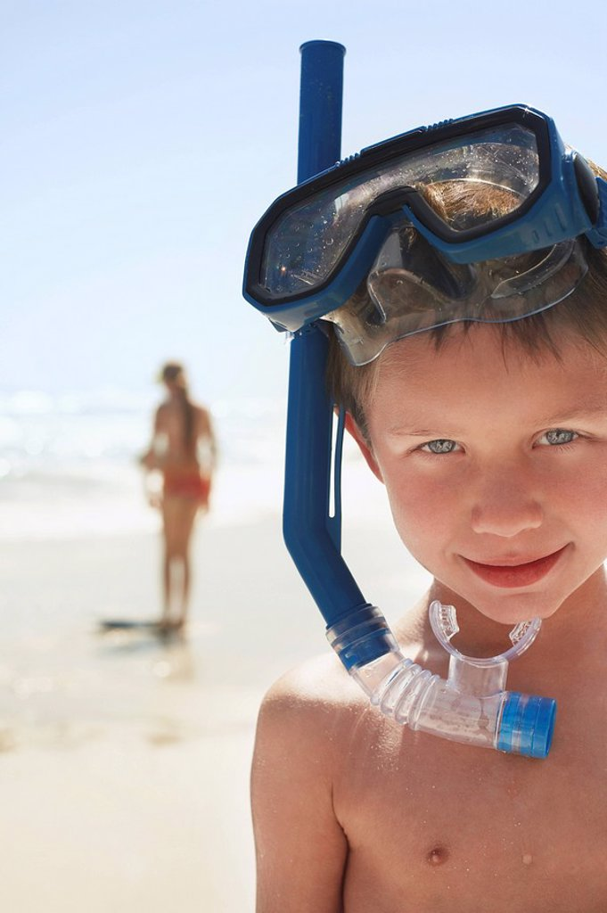 Boy 5_6 in snorkel on beach close_up portrait : Stock Photo