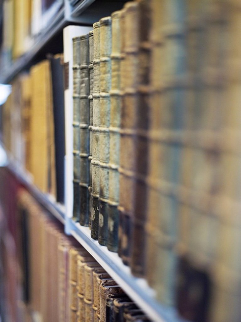 Antique books on shelf : Stock Photo