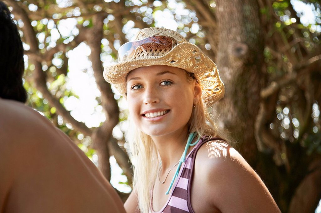 Young woman in sun hat outdoors head and shoulders : Stock Photo