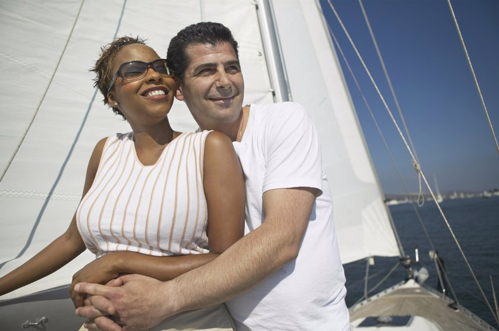 Affectionate Couple Relaxing on Yacht : Stock Photo