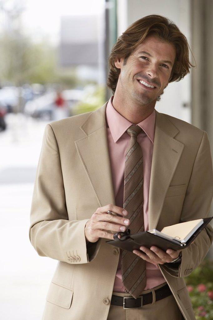 Businessman Using Organizer : Stock Photo