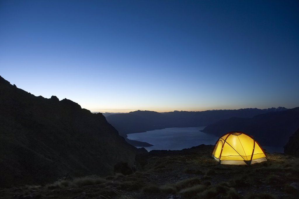 Tent by lakeshore at dusk : Stock Photo