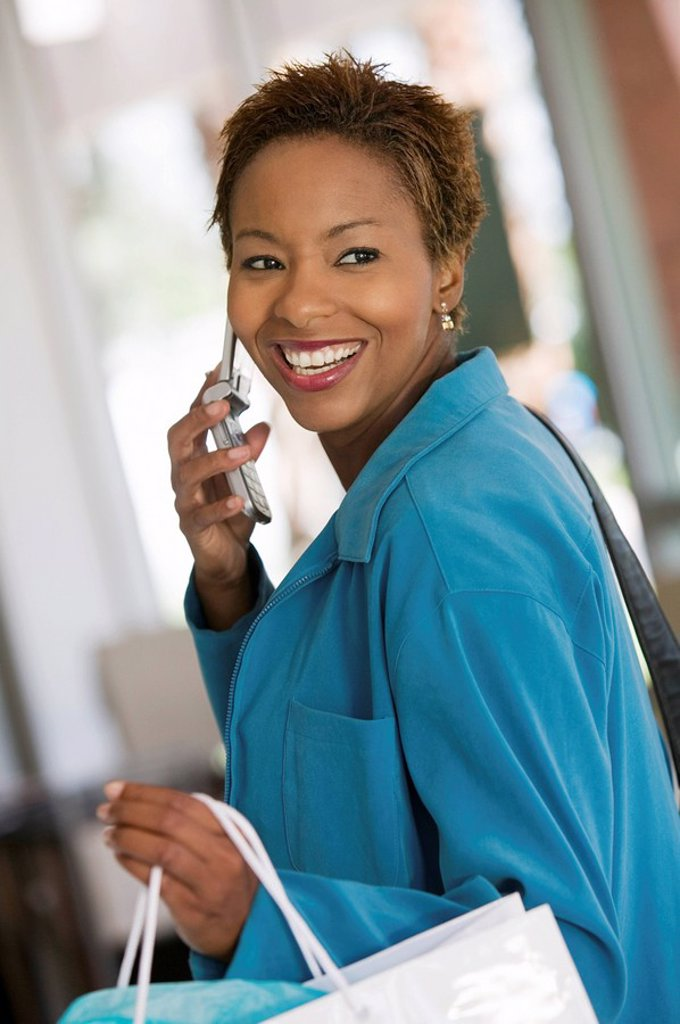 Stock Photo: 1654R-1667 Woman on Cell Phone in furniture store
