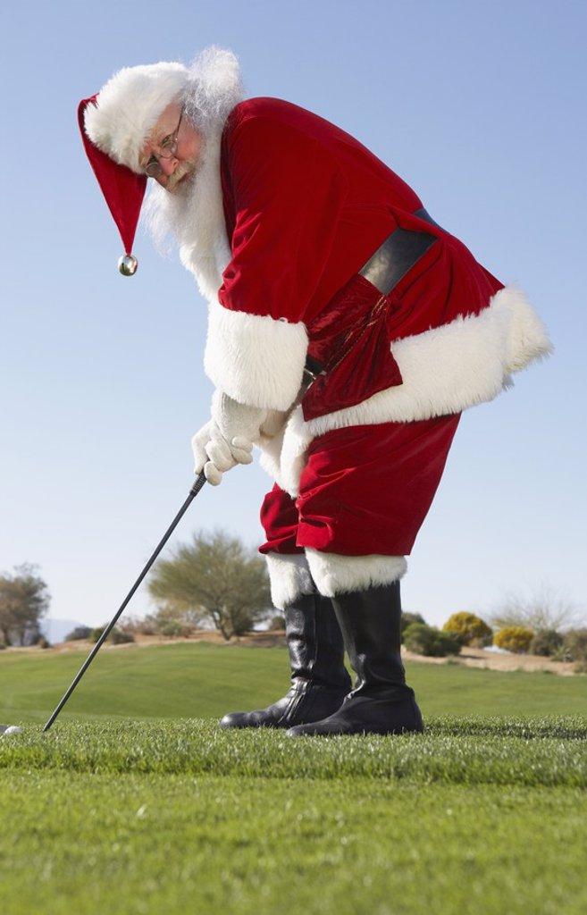 Stock Photo: 1654R-16680 Santa Claus Playing Golf