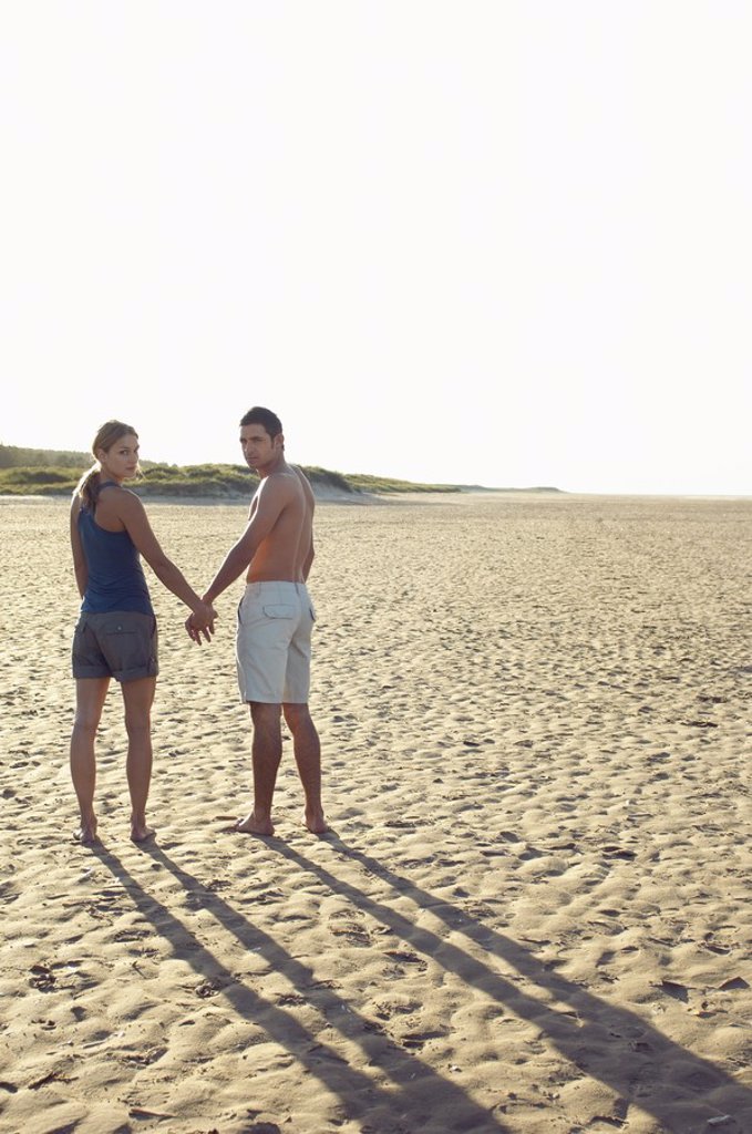 Stock Photo: 1654R-16896 Couple Holding Hands on Beach