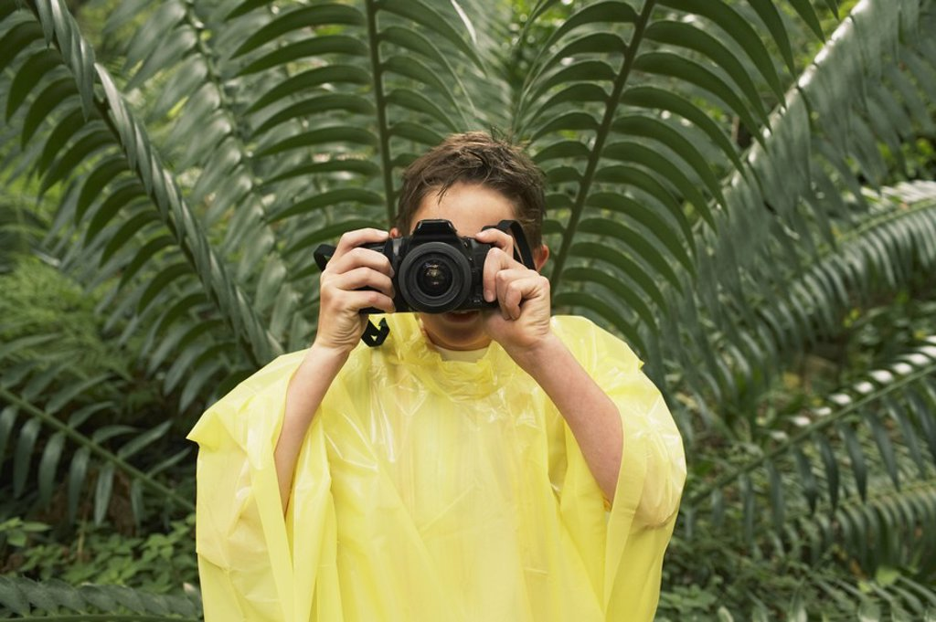 Stock Photo: 1654R-17106 Boy with Camera