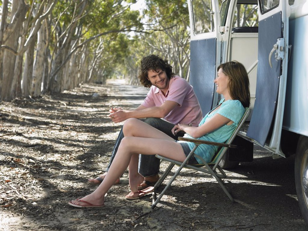 Stock Photo: 1654R-17147 Young Couple Resting on Road Trip