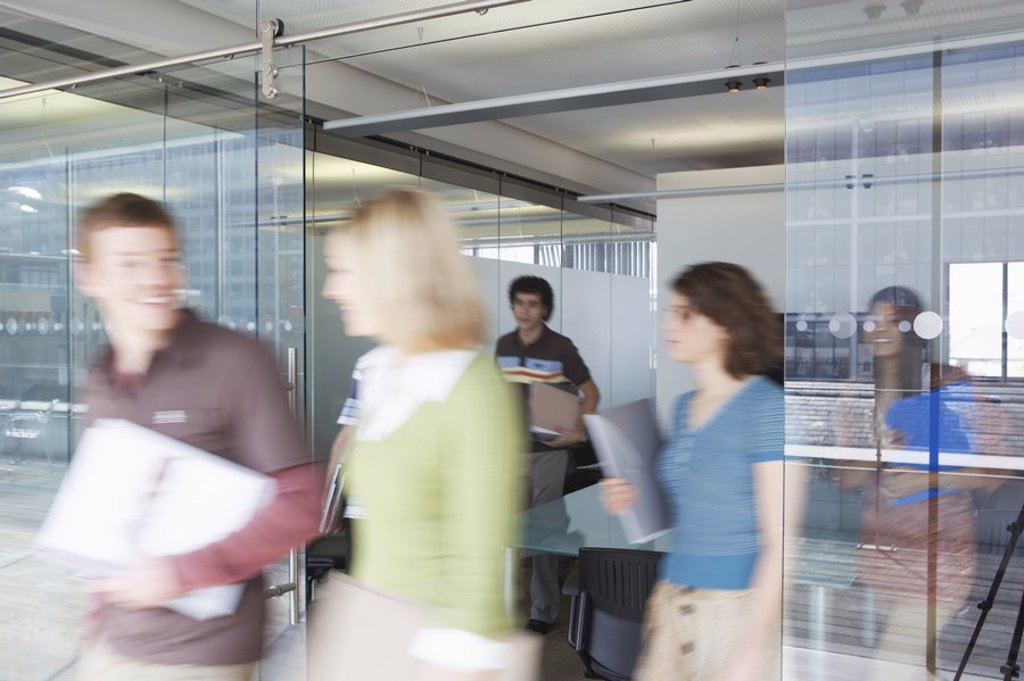 Office workers leaving conference room long exposure : Stock Photo