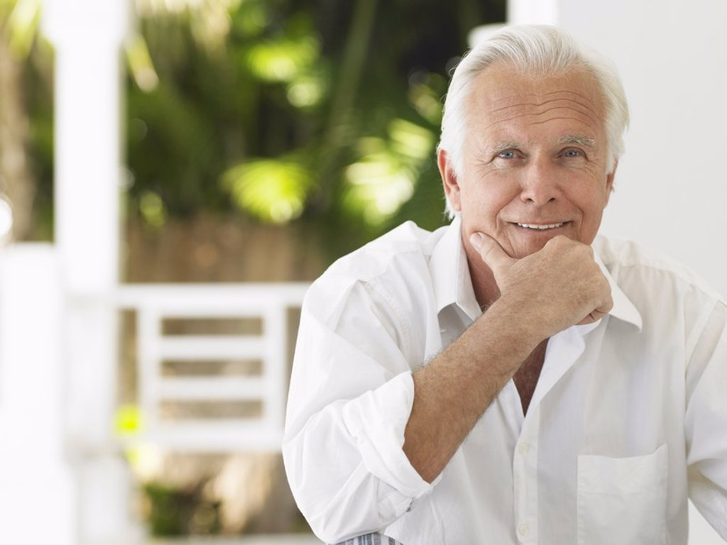 Man sitting on verandah portrait : Stock Photo