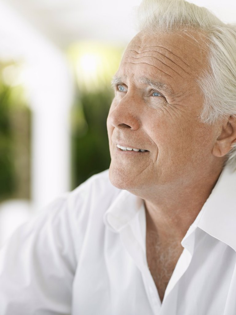 Senior man looking up and smiling : Stock Photo