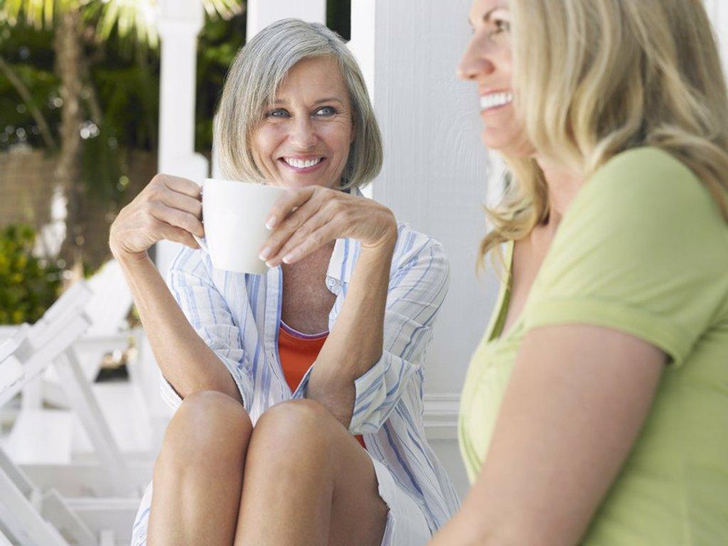 Stock Photo: 1654R-17373 Two women sitting on verandah