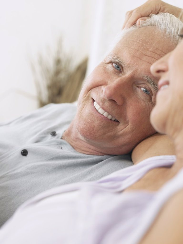 Stock Photo: 1654R-17409 Couple embracing and smiling close_up