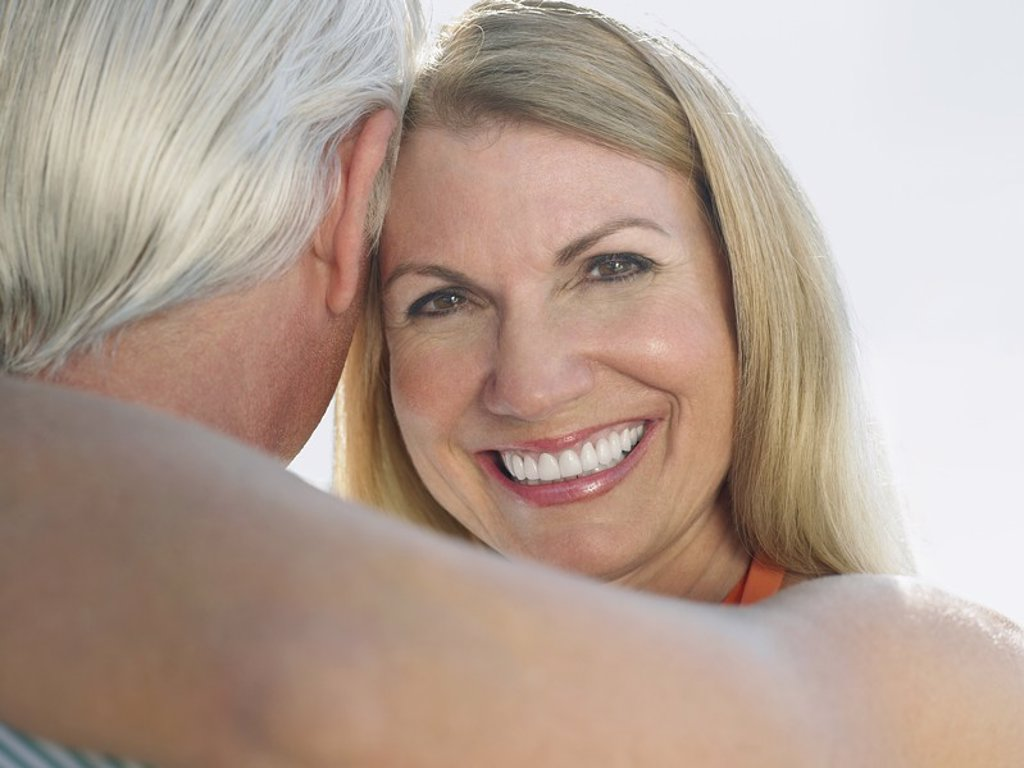 Woman embracing man portrait close up : Stock Photo