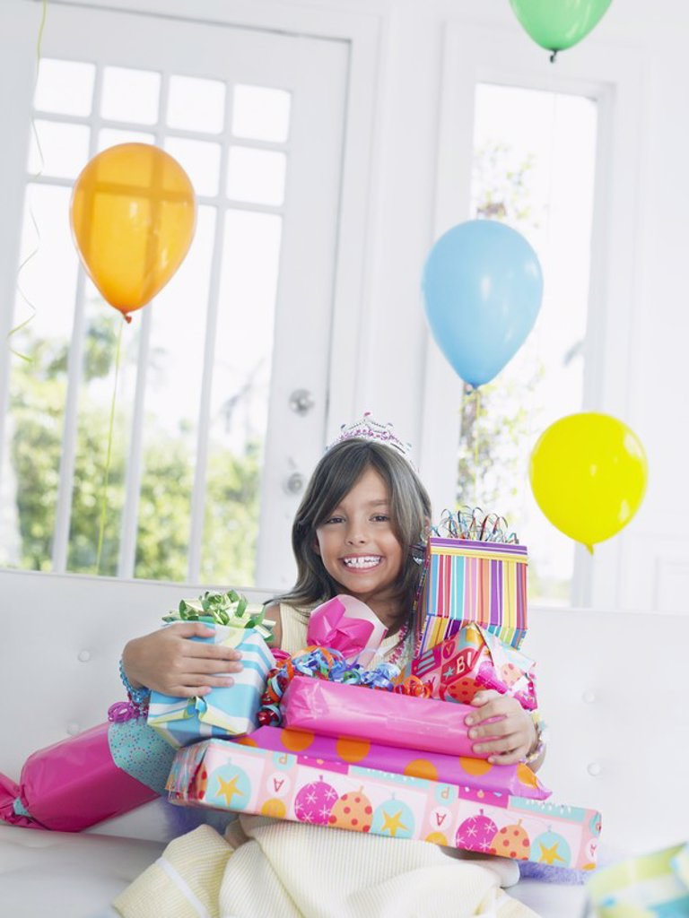 Portrait of young girl 7_9 with birthday presents smiling : Stock Photo