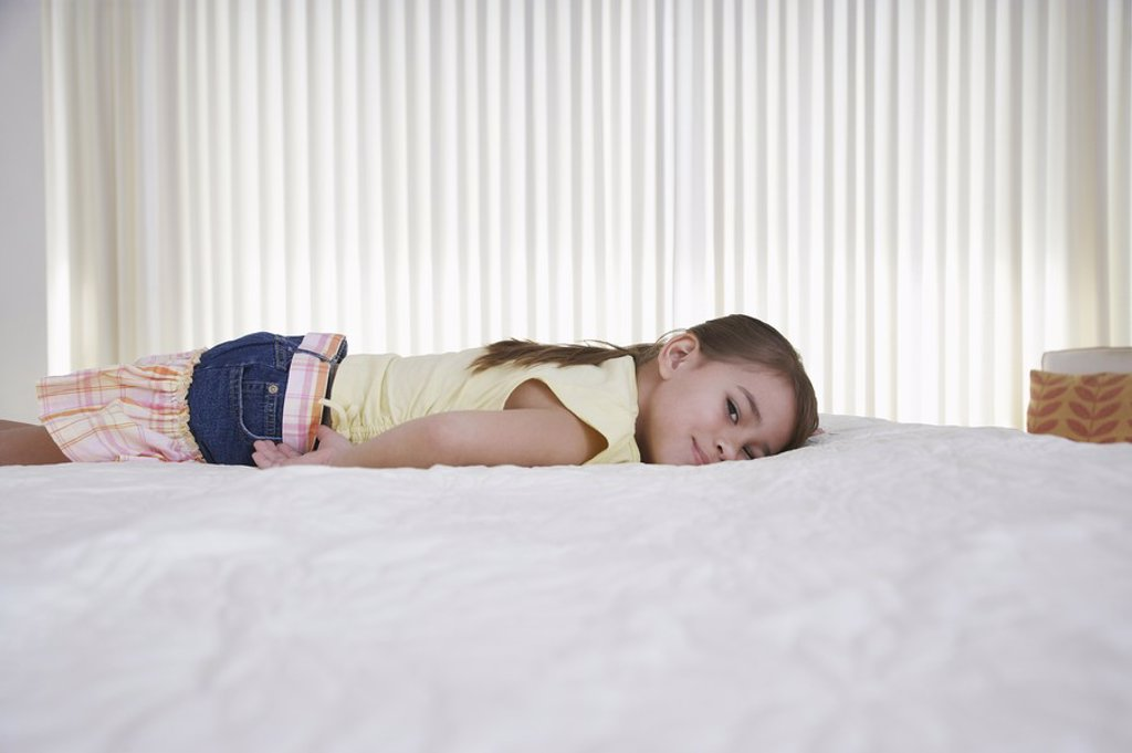 Stock Photo: 1654R-17715 Girl 5_6 lying on bed