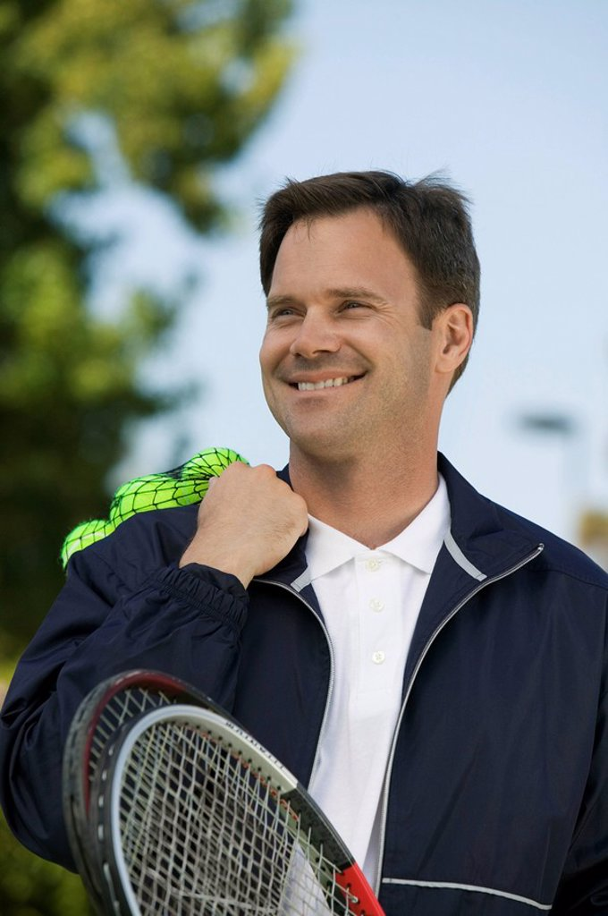 Man with Tennis Racket and tennis balls : Stock Photo