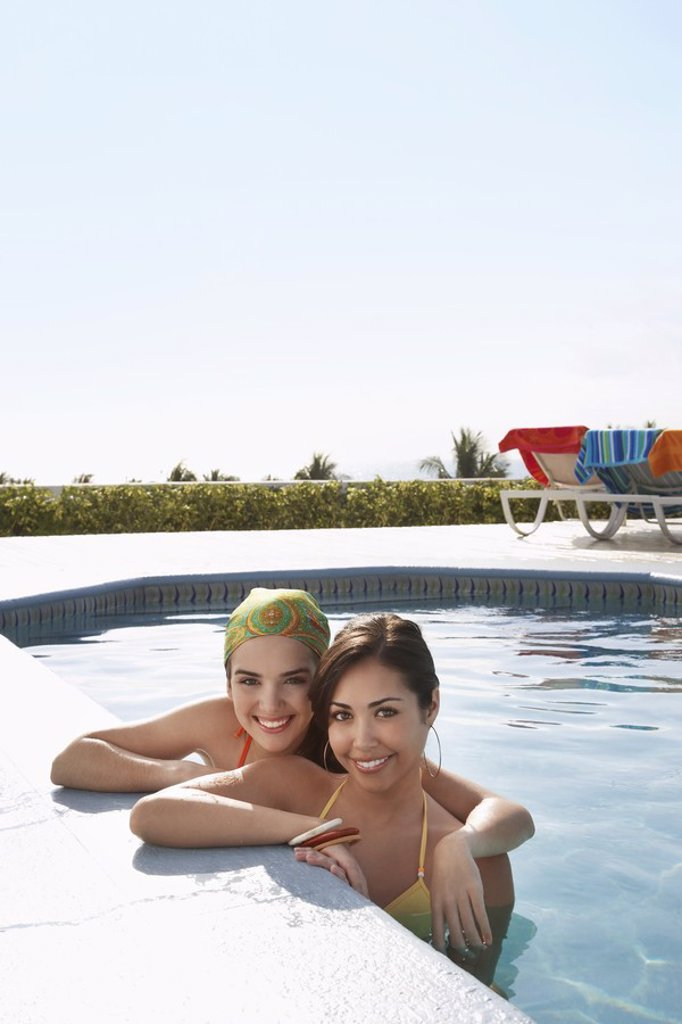 Stock Photo: 1654R-17762 Two teenage girls 16_17 in swimming pool portrait