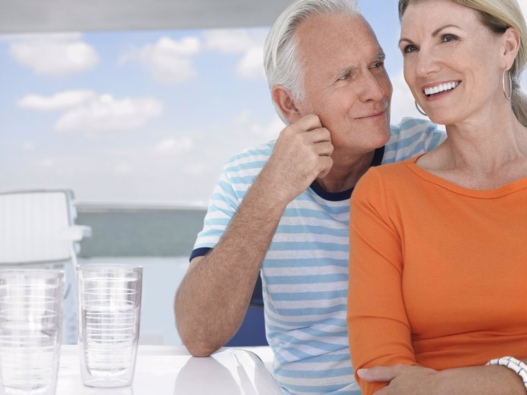 Smiling middle_aged couple outdoors portrait : Stock Photo