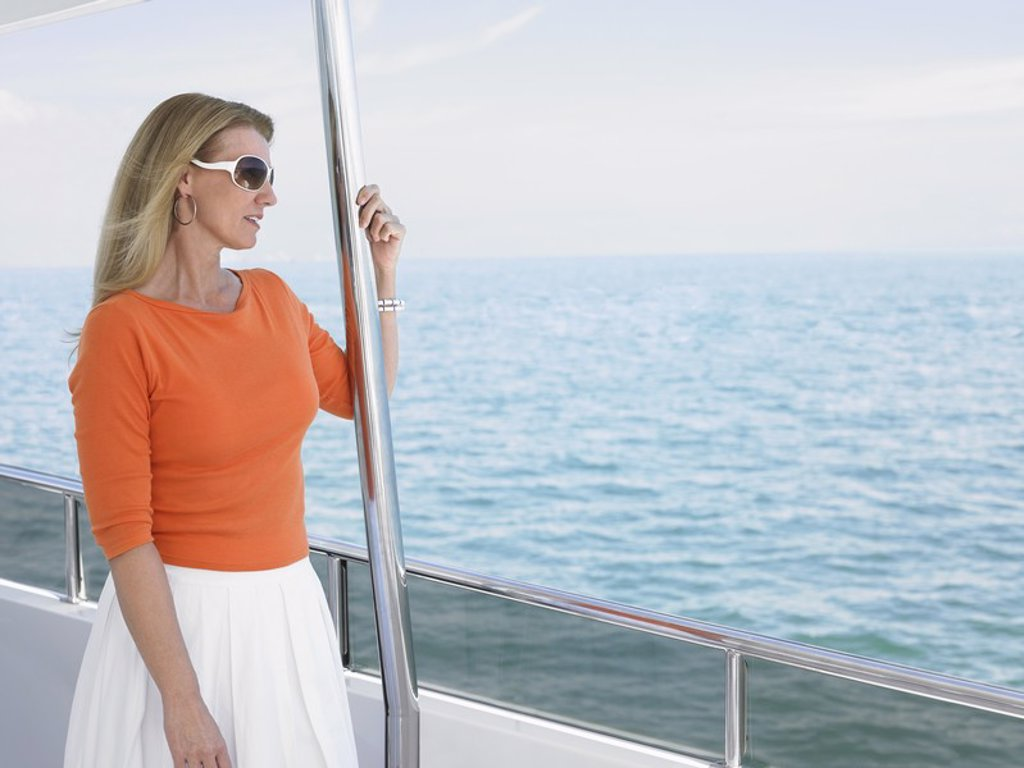 Stock Photo: 1654R-17833 Middle_aged woman on yacht