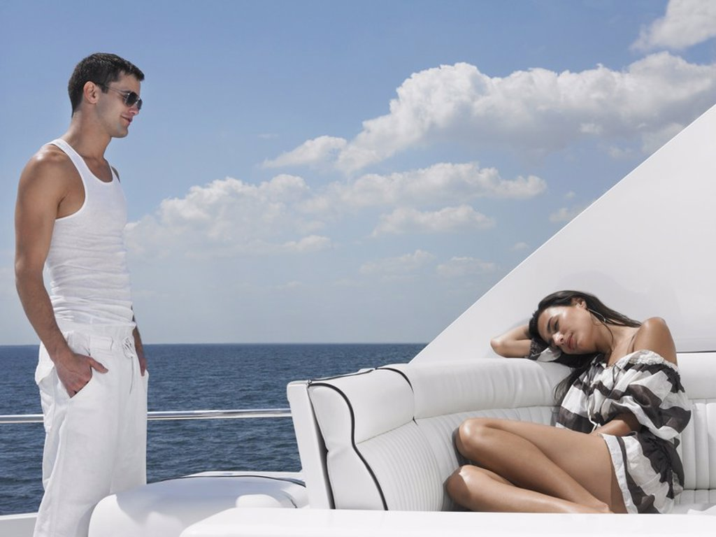 Young couple on yacht : Stock Photo
