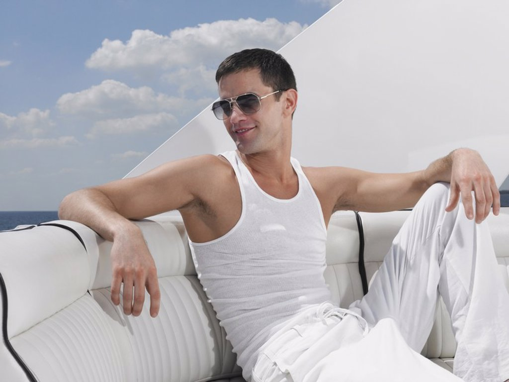 Stock Photo: 1654R-17841 Young man relaxing on yacht