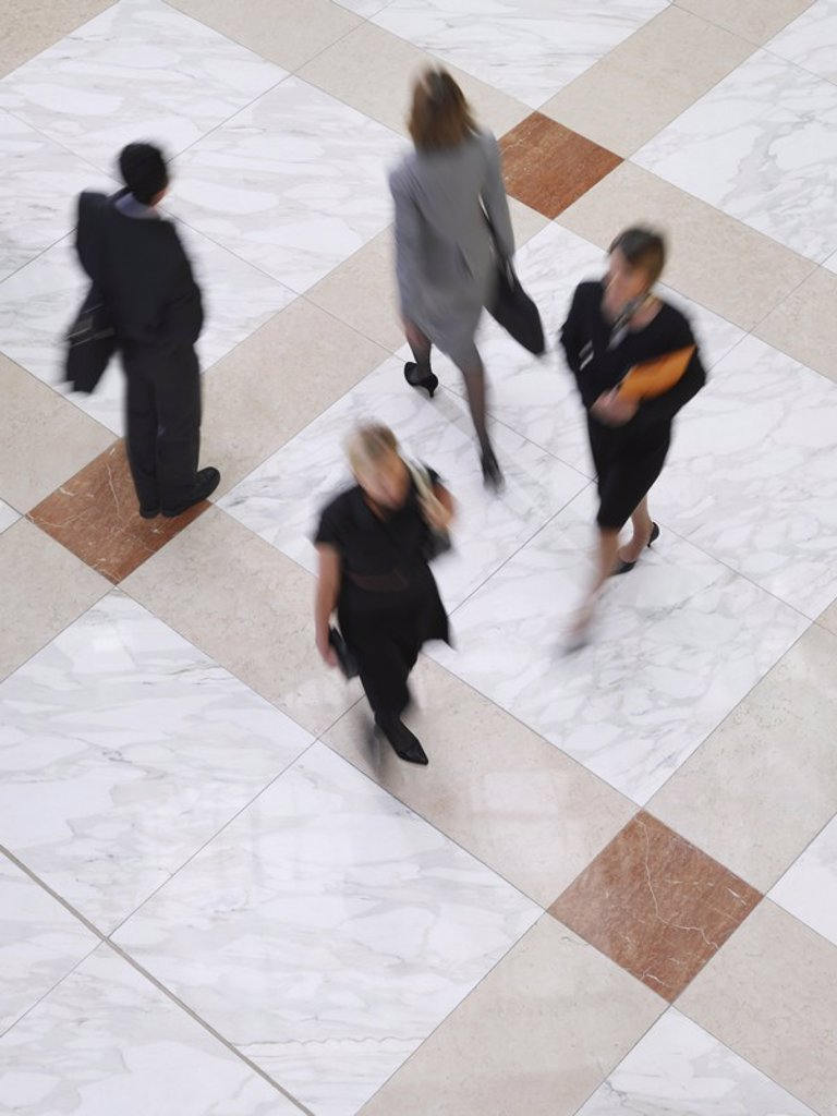 Stock Photo: 1654R-18762 Business people walking elevated view long exposure
