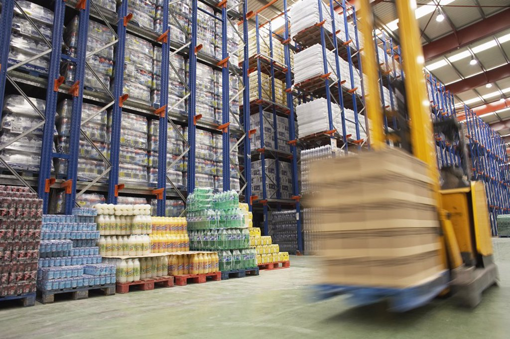 Stock Photo: 1654R-19127 Speeding Forklift in Warehouse