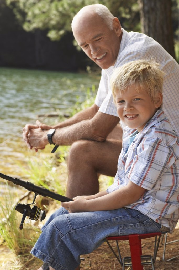 Stock Photo: 1654R-19176 Grandfather and Grandson Fishing