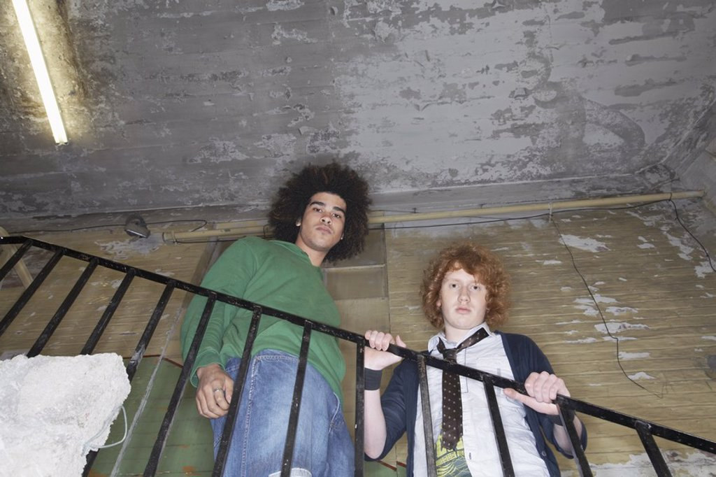 Two young men in old dilapidated building : Stock Photo