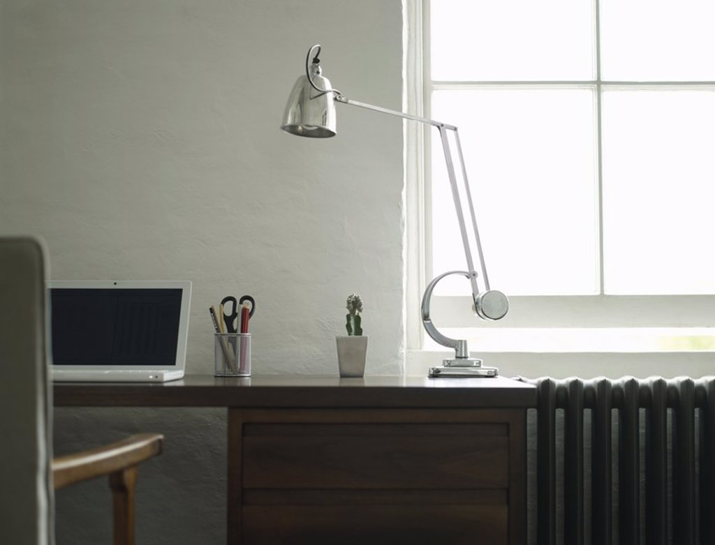 Desk with laptop and lamp : Stock Photo