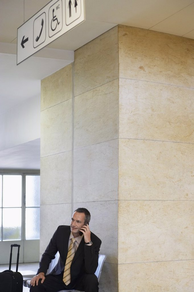 Business man using mobile phone in airport : Stock Photo