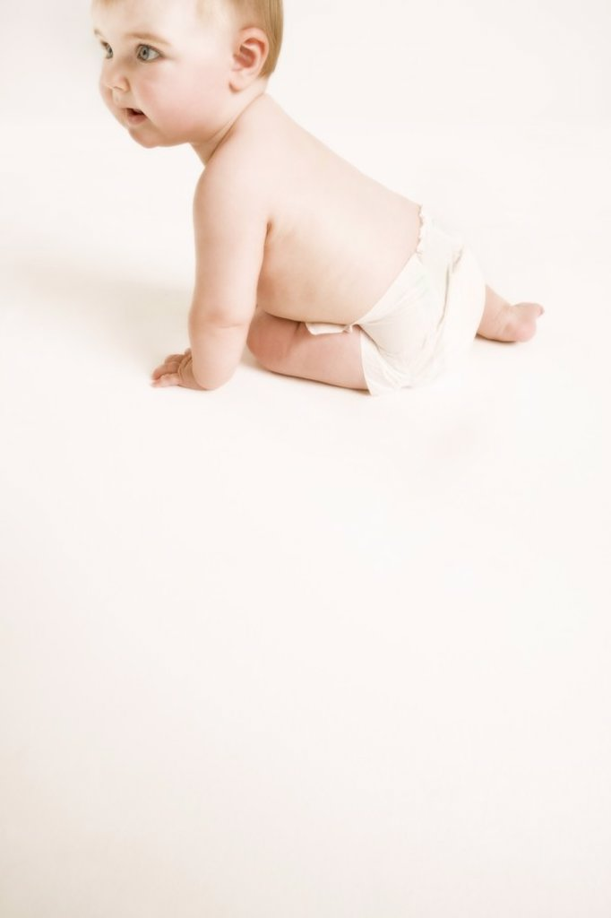Studio shot of baby 1_6 months crawling : Stock Photo