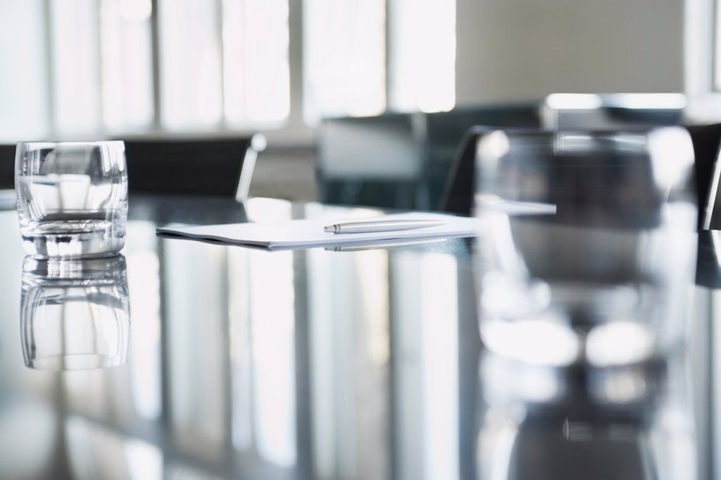 Empty glasses on conference room table : Stock Photo