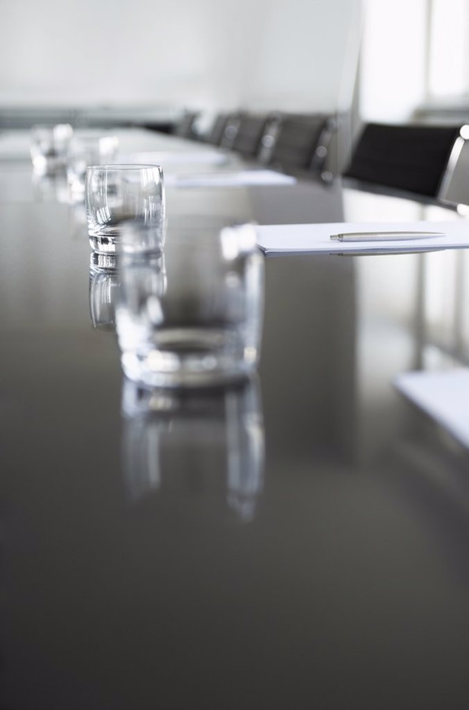 Stock Photo: 1654R-20527 Empty glasses on conference room table