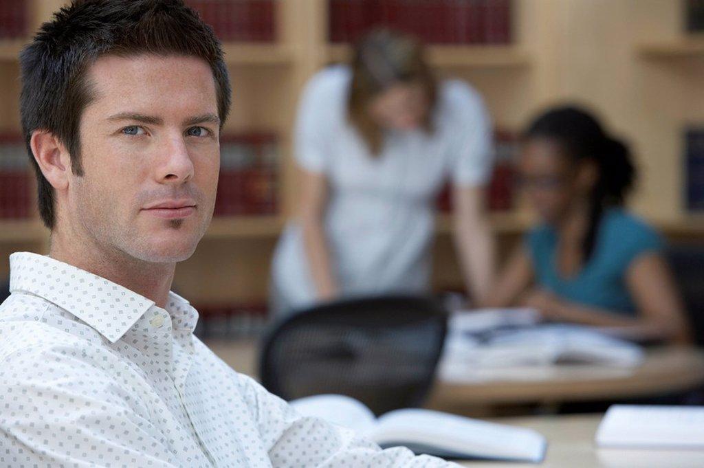 Office worker in office portrait : Stock Photo