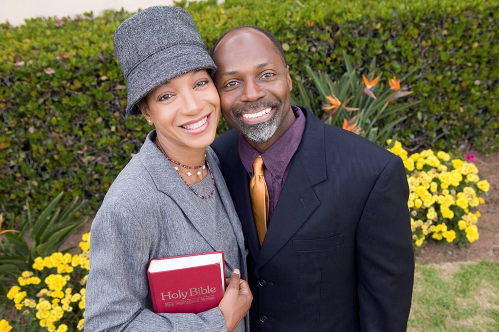 Stock Photo: 1654R-2091 Religious Couple with Bible in garden portrait high angle view