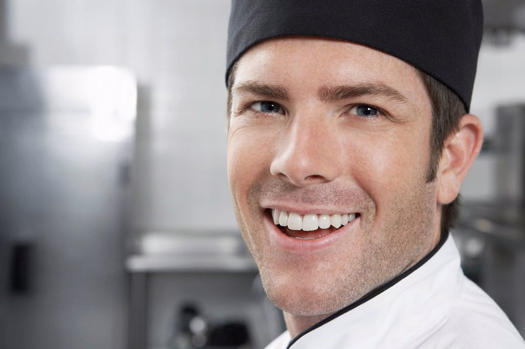 Stock Photo: 1654R-20917 Male chef smiling close_up portrait