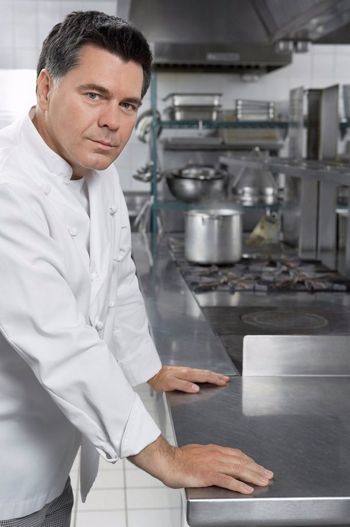 Male chef in kitchen portrait : Stock Photo