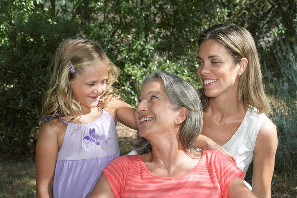 Stock Photo: 1654R-21289 Portrait of grandmother mother and daughter 5_6 in garden