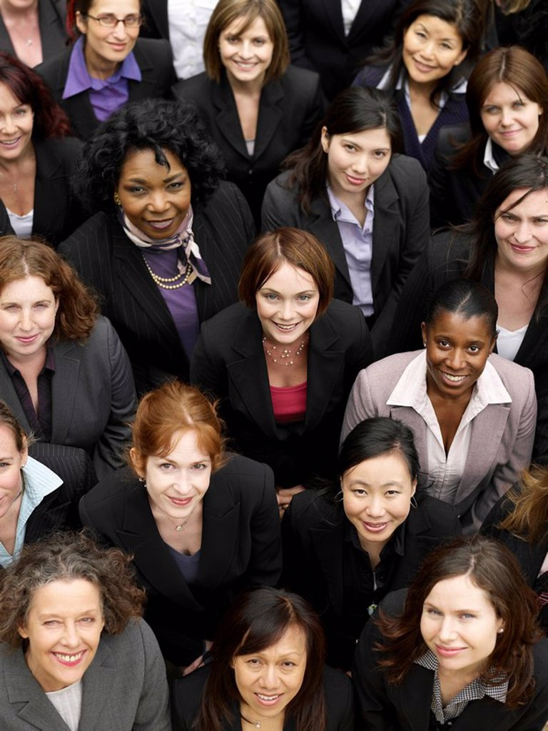 Group of business women looking up portrait elevated view close up : Stock Photo