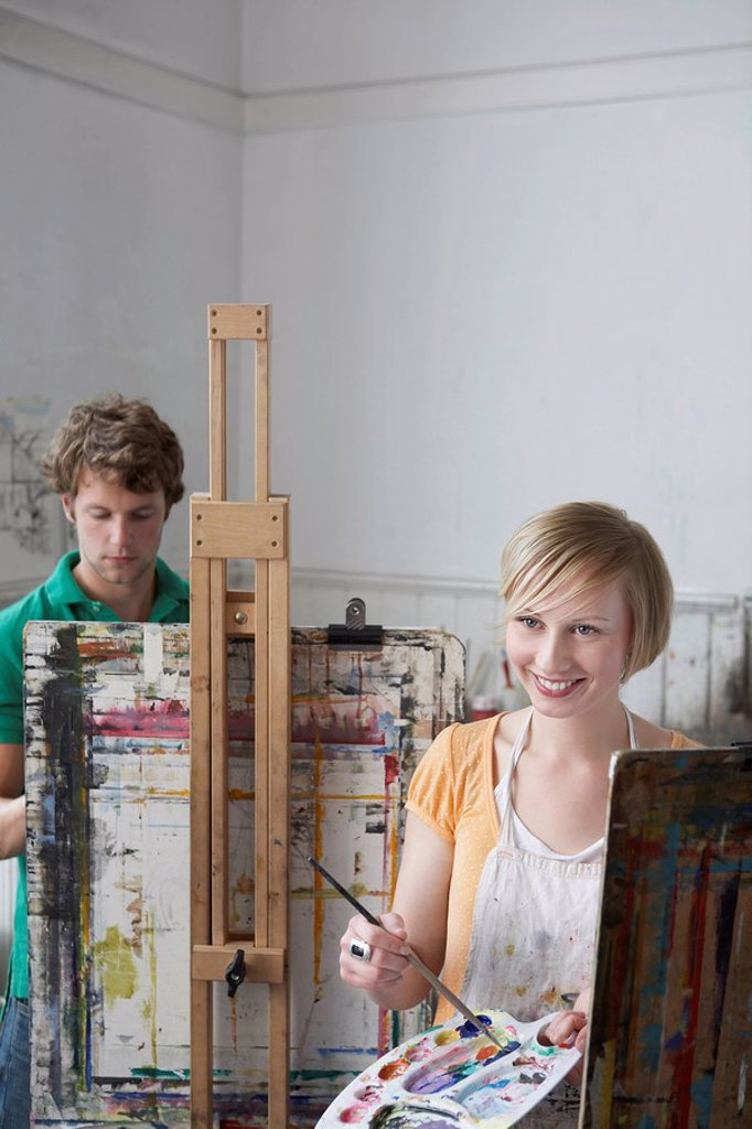 Two artists painting in studio : Stock Photo