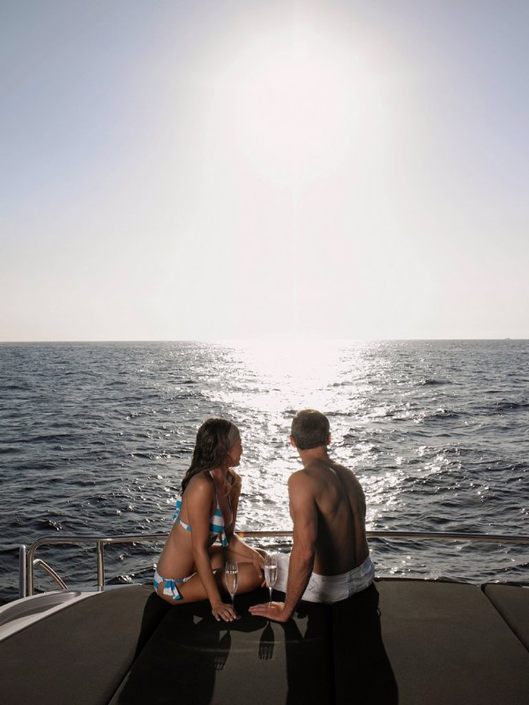 Stock Photo: 1654R-22693 Couple Sunbathing on Boat